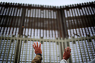 TIJUANA, MEX-FEB 22:  Worshipers participate in a Mass along the U.S.-Mexico border wall in Tijuana, Mexico on Sunday, February 22, 2015.   Senior Republican senators said they expected Congress will avoid a shutdown over the Department of Homeland Security, which faces a partial shutdown on Feb. 27 over a GOP push to roll back President Barack Obama's executive actions on immigration.(Photo by Sandy Huffaker/Getty Images)