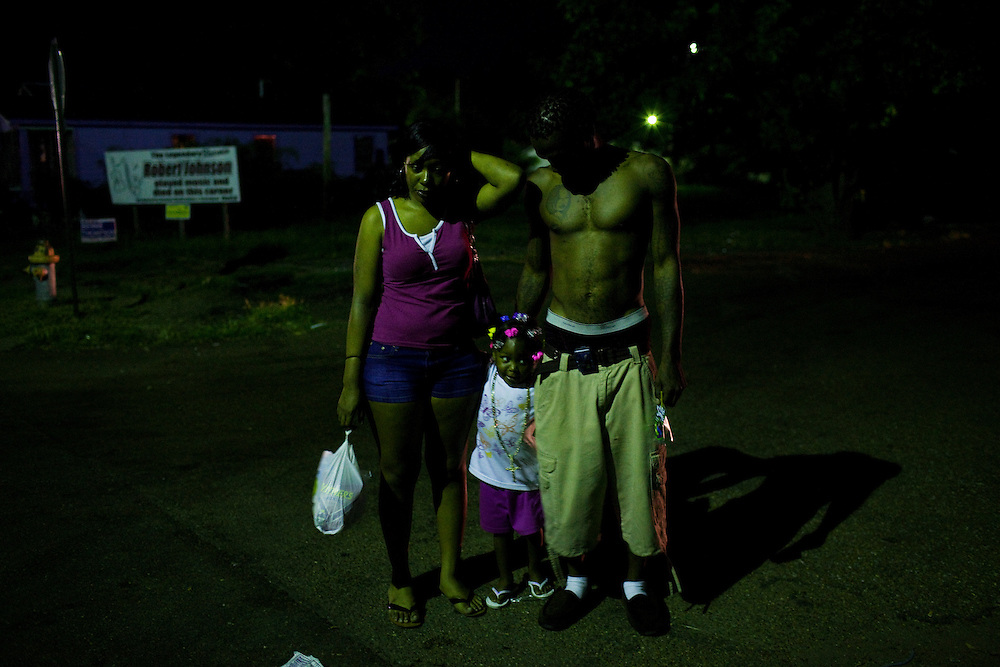 "Mee Mee Williams, Cameariyana, 3,  and Roger ""Winky"" Williams stand on the corner of Young and Pelican in the Baptist Town neighborhood of Greenwood, Mississippi on Sept. 25, 2010."