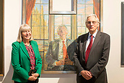 UNITED KINGDOM, London: 08 May 2019 <br /> MP Bruce Grocott, Baron Grocott PC (right), stands next to his portrait painted by Daphne J. Todd (left) at the launch of The Royal Society of Portrait Painters' annual exhibition at The Mall Galleries, London. <br /> The exhibition consists of faces both famous and not-so famous and is a celebration of the very best in contemporary portraiture nationally and internationally.<br /> Rick Findler