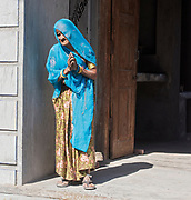 Old woman at the doorstep to her house in the village of Chanoud, Rajasthan, India.