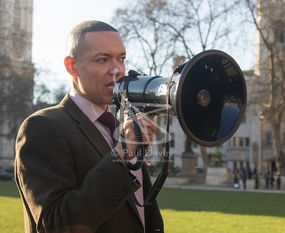"""Westminster, London, January 19th 2016. Students hold an """"emergency protest"""" in Parliament Square and later blocking Westminster Bridge, against the cutting of maintenance grants. """"It took just 18 MPs 90 minutes to scrap maintenance grants for the million poorest students, without a debate in Parliament in a backroom committee"""" PICTURED: Labour Shadow Energy Minister Clive Lewis addresses the gathering . ///FOR LICENCING CONTACT: paul@pauldaveycreative.co.uk TEL:+44 (0) 7966 016 296 or +44 (0) 20 8969 6875. ©2015 Paul R Davey. All rights reserved."""