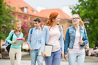 Young university friends walking on street