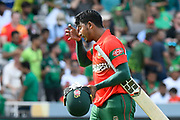 Wicket - Mosaddek Hossain of Bangladesh looks dejected as he walks back to the pavilion after being dismissed by Shadab Khan of Pakistan during the ICC Cricket World Cup 2019 match between Pakistan and Bangladesh at Lord's Cricket Ground, St John's Wood, United Kingdom on 5 July 2019.
