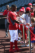 ANAHEIM, CA - MAY 17:  Howie Kendrick #47 of the Los Angeles Angels of Anaheim signs autographs before the game against the Tampa Bay Rays at Angel Stadium on Saturday, May 17, 2014 in Anaheim, California. The Angels won the game in a 6-0 shutout. (Photo by Paul Spinelli/MLB Photos via Getty Images) *** Local Caption *** Howie Kendrick