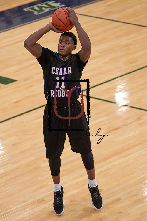 Cedar Ridge's De'Andre Davis in play action against McNeil Friday at McNeil Gym.  (LOURDES M SHOAF for Round Rock Leader.)