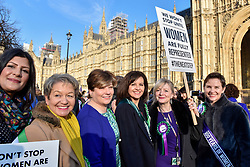 © Licensed to London News Pictures. 06/02/2018. LONDON, UK.  (3rd left) Emily Thornberry joins female members of the Shadow Cabinet and Labour politicians outside the Houses of Parliament, wearing Labour styled suffragette rosettes, holding placards next to a '100 Years of Women Voting' banner to help launch Labour's campaign to celebrate 100 years of women's suffrage.    Photo credit: Stephen Chung/LNP