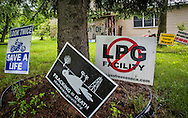 Anti-fracking signs on Ray Kem's lawn in Dimock PA, where many people's wells became contaminated after the fracking industry started drilling in the area.