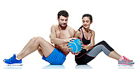 one caucasian couple man and woman exercising fitness Medicine Ball exercises isolated on white background