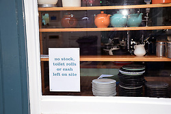 Humerous Coronavirus sign on window of closed cafe during lock down, Norwich UK March 2020