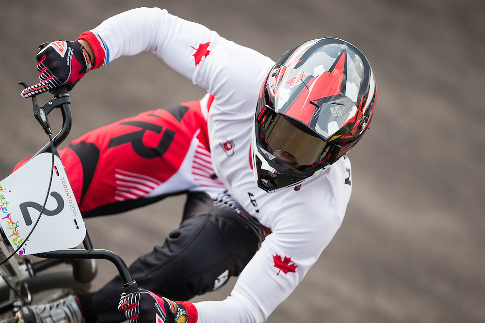 Tory Nyhaug of Canada rides in the semi-final at the BMX at the 2015 Pan American Games in Toronto, Canada July 11,  2015.  AFP PHOTO/GEOFF ROBINS