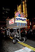 The Biscuit Brothers riding a giant supermarket cart in the Grand Procession on New Year's Eve in Austin Texas as part of the First Night 2009 celebration, December 31, 2008. First Night is an annual celebration of the arts  held on New Year's Eve in Austin Texas.