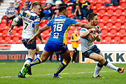 Doncaster RLFC second row Charlie Martin (18) dislodges the ball from Featherstone Rovers scrum half Tom Holmes (19)  during the Challenge Cup 2018 match between Doncaster and Featherstone Rovers at the Keepmoat Stadium, Doncaster, England on 22 April 2018. Picture by Simon Davies.