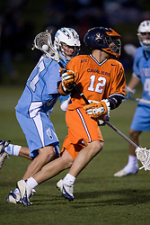 Virginia Cavaliers M Drew Thompson (12) runs around North Carolina Tar Heels Michael Jarvis (37).  The Virginia Cavaliers Men's Lacrosse Team defeated the North Carolina Tar Heels 10-9 in overtime at Klockner Stadium in Charlottesville, VA on April 7, 2007.