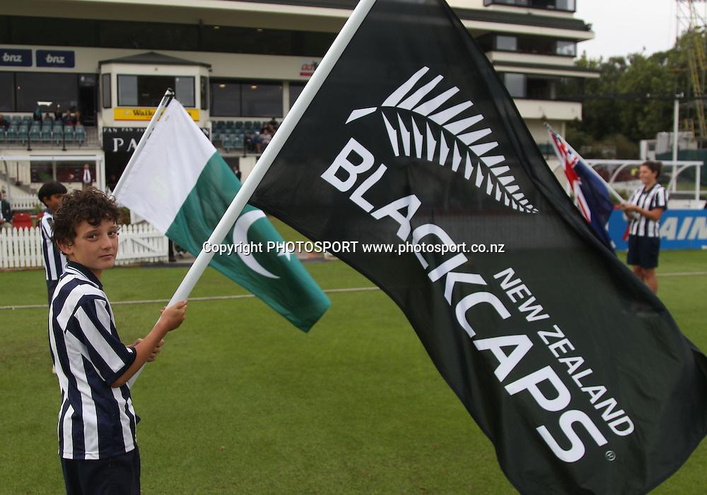 Flag Bearers. New Zealand Black Caps v Pakistan, Match 2. Twenty 20 Cricket match at Seddon Park, Hamilton, New Zealand. Tuesday 28 December 2010. Photo: Andrew Cornaga/photosport.co.nz