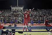 MELISSA LYTTLE   |   Times<br /> With a pretty full stadium behind them, Pahokee Blue Devils Dontrell &quot;Fred Johnson (2) and Leon Anderson (16) stand on the bench and cheer for their team during their Homecoming game while the offense was on the field.