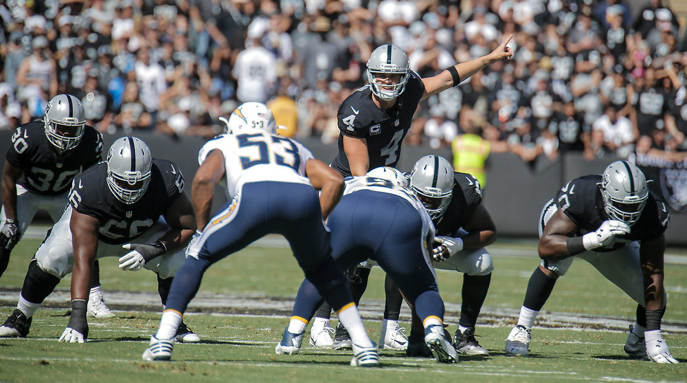 Oct 09 2016 - Oakland U.S. CA - Raiders Derek Carr threw a go-ahead 21-yard touchdown pass to Michael Crabtree on a fourth-and-2 gamble and added another TD pass to Amari Cooper to lead the Oakland Raiders to a 34-31 victory over the mistake-prone San Diego Chargers at O.co Coliseum Stadium Oakland Calif. Thurman James / CSM