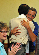 Tom Saal, of Akron, writes poetry to help with Post-traumatic stress disorder.  Saal hugs  Vietnamese Veteran, Pham Xuan Hang a professor at the University of Vietnam in Hanoi, after each read poetry about their combat experiences during the war in Vietnam. (Laura FongTorchia/Special to the Akron Beacon Journal)