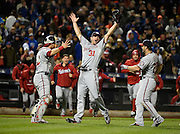 Washington Nationals starting pitcher Max Scherzer celebrates his no hitter against the New York Mets with teammates, catcher Wilson Ramos (40) and Dan Uggla (26) in the second baseball game of a doubleheader, Saturday, Oct. 3, 2015, in New York. The Nationals won 2-0. (AP Photo/Kathy Kmonicek)