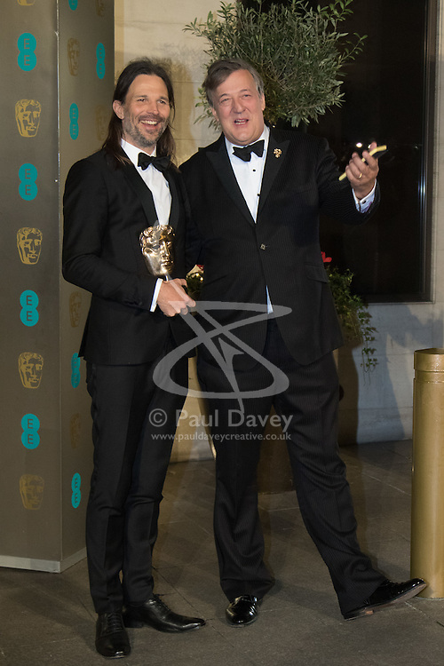 Photo Must Be Credited ©Alpha Press<br /> Linus Sandgren and Stephen Fry arrive at the EE British Academy Film Awards after party dinner at the Grosvenor House Hotel in London.