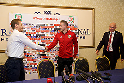 TIRANA, ALBANIA - Monday, November 19, 2018: Wales' Chris Gunter shakes hands with the translator during a press conference at the Tirana International Hotel ahead of the International Friendly match between Albania and Wales. (Pic by David Rawcliffe/Propaganda)