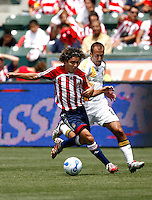 20 May 2007:  Chivas #6 Fransico Mendoza dribbles the ball away from Peter Vagenas during a 1-1 tie for MLS Chivas USA vs. Los Angeles Galaxy pro soccer teams at the Home Depot Center in Carson, CA.