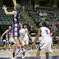 Patriot guard Eric Laurent (42) lays up for two while Jaguar Dexter Walker (5) looks on.