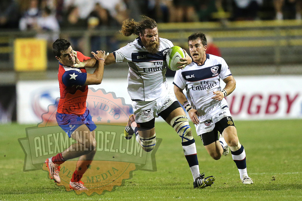United States Captain Todd Clever (7) stiff arms a Chile player during the 2016 Americas Rugby Championship match at Lockhart Stadium on Saturday, February 20, 2016 in Fort Lauderdale, Florida.  (Alex Menendez via AP)