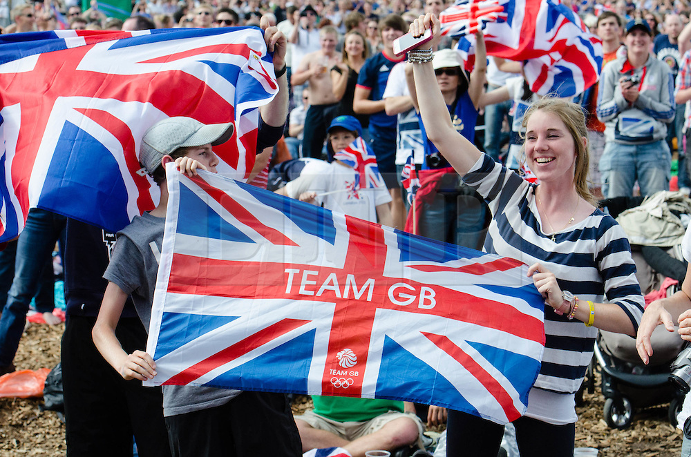 © Licensed to London News Pictures. 05/08/2012. London, UK.     People watch the mens tennis on screen at BT London Live Hyde Park and celebrate as Andy Murray beats Roger Federer to win a Gold Medal in the men's Olympic Tennis. Photo credit : Richard Isaac/LNP