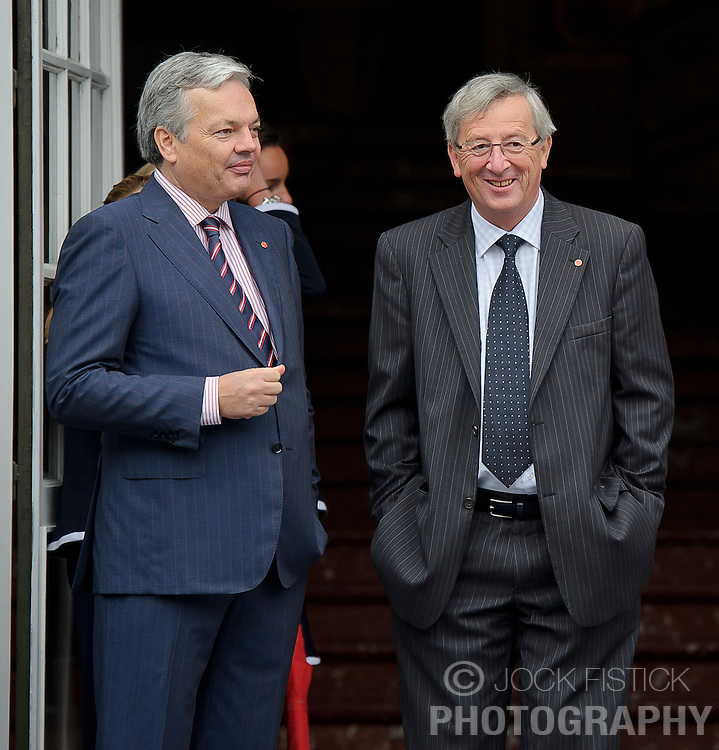 Jean-Claude Juncker, Luxembourg's prime minister, and president of the Eurogroup, right, speaks with Didier Reynders, Belgium's finance minister, left, as they arrive for the Eurogroup meeting in Brussels, Thursday Sept. 30, 2010. (Photo © Jock Fistick)