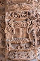 Intricate stone carvings on the cloister columns at Quwwat ul-Islam Mosque, Qutb complex, Delhi – Resembles Hindu Temple Pillars – Pillars taken from Hindu temples.