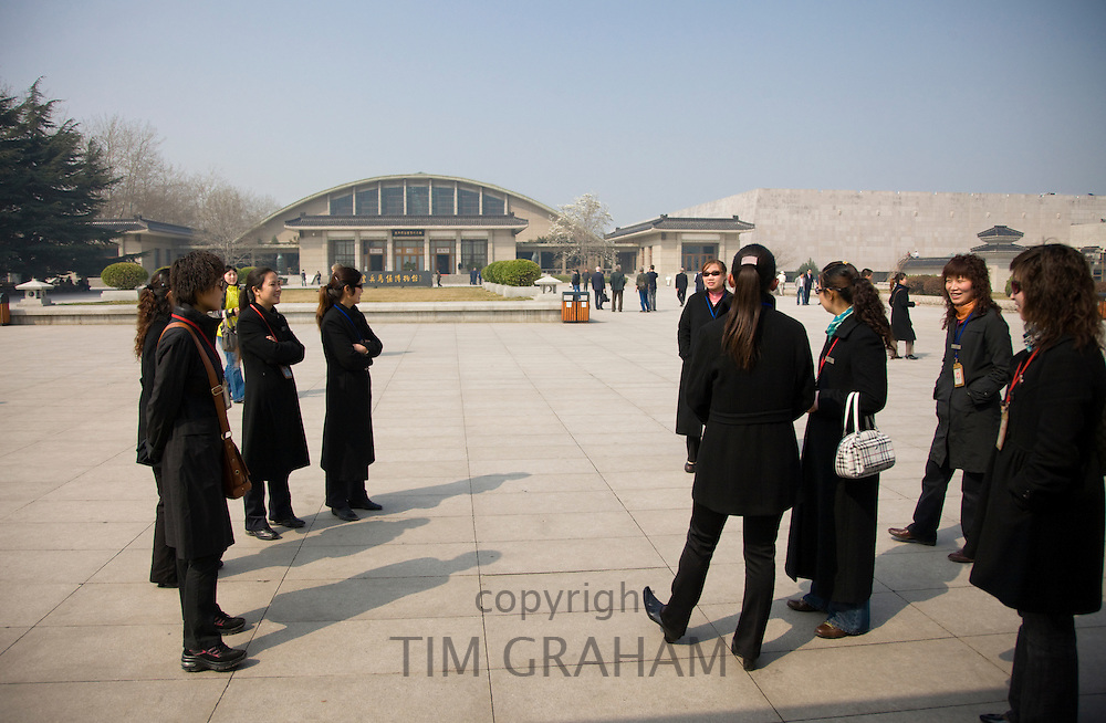 Tour guides gather outside the Qin Museum, exhibition halls of Terracotta Warriors, Xian, China