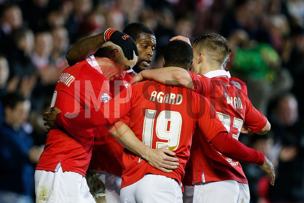 Jay Emmanuel-Thomas of Bristol City celebrates with Aaron Wilbraham, Kieran Agard and Joe Bryan after scoring a goal to make it 3-0 - Photo mandatory by-line: Rogan Thomson/JMP - 07966 386802 - 17/03/2015 - SPORT - FOOTBALL - Bristol, England - Ashton Gate Stadium - Bristol City v Crewe Alexandra - Sky Bet League 1.