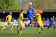 AFC Wimbledon striker Tyrone Barnett (23) winning a header during the EFL Sky Bet League 1 match between AFC Wimbledon and Bristol Rovers at the Cherry Red Records Stadium, Kingston, England on 8 April 2017. Photo by Matthew Redman.