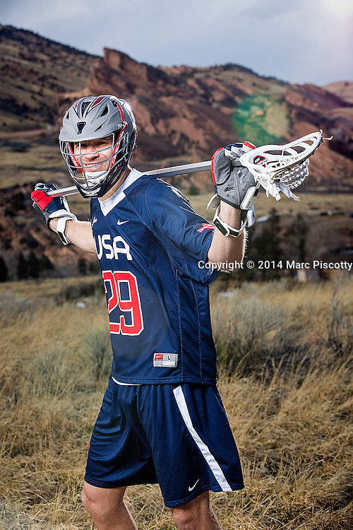 SHOT 2/22/14 4:14:05 PM - Denver Outlaws and Team USA defenseman Lee Zink poses for a portrait with Red Rocks and the foothills just outside of Denver, Co. in the background. Zink was named the 2012 Major League Lacrosse Defensive Player of the Year. When Zink grew up in Darien, Conn., and started his lacrosse career in sixth grade, he knew defense would be his calling card from the beginning. Zink will be playing in Denver this summer in the 2014 FIL World Lacrosse Championships.<br /> (Photo by Marc Piscotty / &copy; 2014)