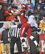 Arkansas Razorbacks cornerback Tevin Mitchel (23) intercepts a pass to Ole Miss Rebels wide receiver Markell Pack (11) at Donald W. Reynolds Razorback Stadium in Fayetteville, Ark. on Saturday, November 22, 2014.