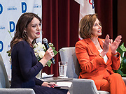 26 OCTOBER 2019 - DES MOINES, IOWA: LINDSAY PAULSON (left) introduces Congresswoman NANCY PELOSI (D-CA), Speaker of the House of Representatives, during an appearance by Speaker Pelosi at Drake University. Speaker Pelosi talked about her experiences as Speaker of the House after the Democrats took back the House of Representatives in the 2018 midterm elections.         PHOTO BY JACK KURTZ