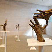 Fifteen Pairs of Hands by Bruce Nauman on display at the National Gallery of Art in Washington DC.