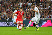 England's Gary Cahill & Switzerland's Xherdan Shaqiri  during the UEFA European 2016 Qualifying match between England and Switzerland at Wembley Stadium, London, England on 8 September 2015. Photo by Shane Healey.