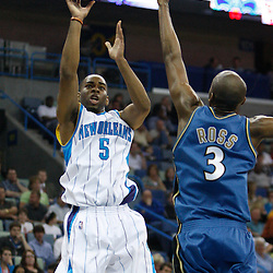 Mar 31, 2010; New Orleans, LA, USA; New Orleans Hornets guard Marcus Thornton (5) shoots over Washington Wizards forward Quinton Ross (3) during the first half at the New Orleans Arena. Mandatory Credit: Derick E. Hingle-US PRESSWIRE