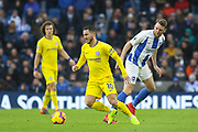 Chelsea Midfielder Eden Hazard battles with Brighton and Hove Albion midfielder Dale Stephens (6) during the Premier League match between Brighton and Hove Albion and Chelsea at the American Express Community Stadium, Brighton and Hove, England on 16 December 2018.