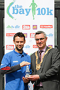 No fee for Repro:.Stephen Moore third place at the DLR Bay 10K road race in a time of 33.33 minutes pictured been presented with his winning prize by An Cathaoirleach Cllr Tom Joyce, Dun Laoghaire-Rathdown County Council. Pic Jason Clarke Photography