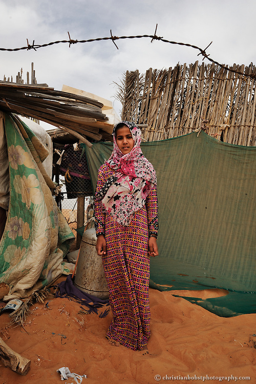 A beduin girl living in the desert of Wahiba Sands. Oman, 2011