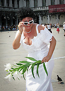 A bride poses in St Mark's Square, Venice, Italy. Photograph by Debbie Zimelman, Modiin, Israel