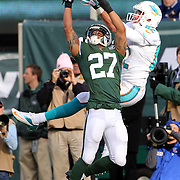 Dee Milliner, New York Jets and Brian Hartline, Miami Dolphins, challenge for a reception during the New York Jets Vs Miami Dolphins  NFL American Football game at MetLife Stadium, East Rutherford, NJ, USA. 1st December 2013. Photo Tim Clayton