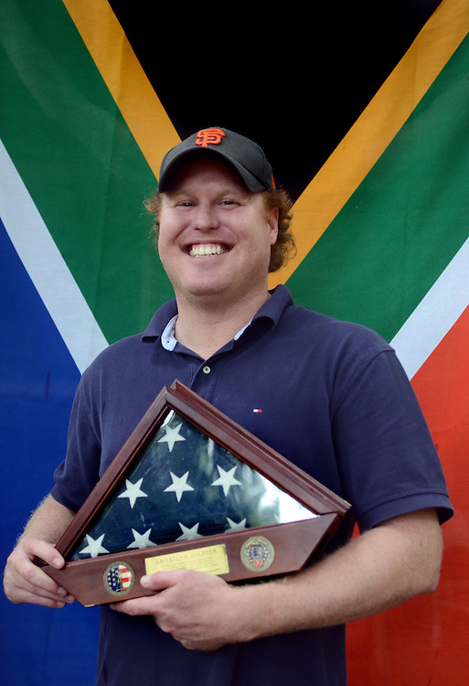 U.S. Army veteran Dale Moorhouse poses for a picture with his native South African flag behind him and his United States of America flag in his hands at his house in Hattiesburg. The South African native served half of his tour of duty before being nationalized as an United States citizen in June of 2005. Bryant Hawkins/The Hattiesburg American