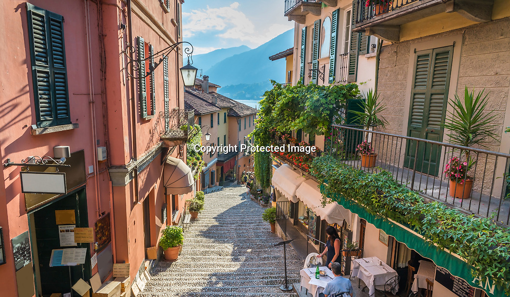 Shops on Salita Serbelloni in the historic old town with the lake in the distance, Bellagio, Lake Como, Lombardy, Italy