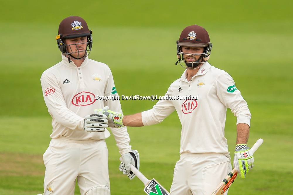 London,UK. 29 August 2017. Ben Foakes is congratulated by Jason Roy after reaching his fifty batting for Surrey against Middlesex at the Oval on day two of the Specsaver County Championship match at the Oval. David Rowe/ Alamy Live News
