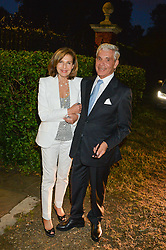 SIMON & JOYCE REUBEN attending Annabel Goldsmith's Summer party held at her home in Ham, Surrey on 10th July 2014.