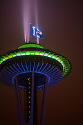 The 12th Man flag flies above the Space Needle in Seattle. Photo by John Lill