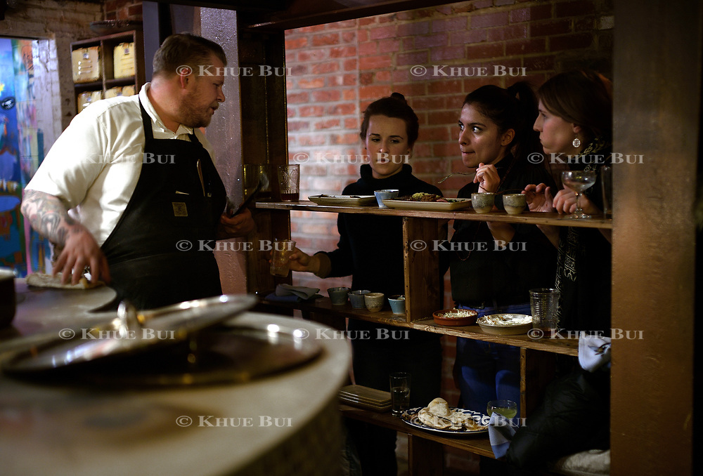 Chef Gerald Addison speaks to guests during dinner at Maydan Friday, January 26, 2018, in Washington, DC.<br /> <br /> Photo by Khue Bui